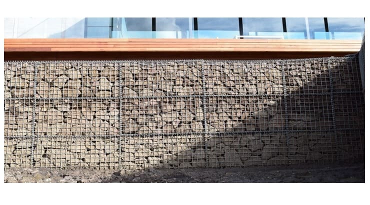 Gabion, comes from the Italian term for 'cage' and that is exactly what a gabion retaining wall is