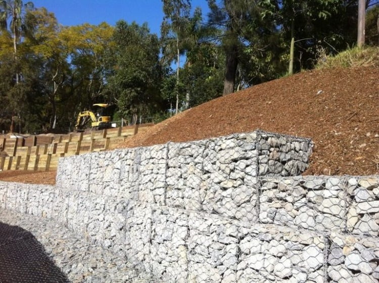 Gabion walls are a popular fencing solution in residential and commercial landscape settings