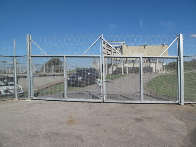 Promax mesh and chainwire through to Palisade type gates